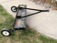 Lawn dethatcher for riding lawn mower