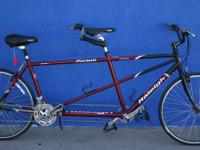 Available for sale is a Raleigh Quest Tandem Bike. This
