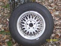 A SET OF FOUR WHEELS AND TIRES THAT ARE IN EC