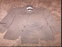 I am selling a Ralph Lauren light brown suit in