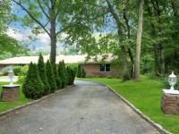 Set On 2.2 Park-Like Acres, This Renovated Ranch