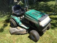 Ranch King green riding mower,. Bought 5-4-1999. New