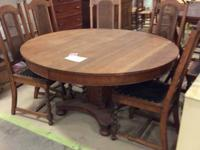 Large round antique oak dining/kitchen table circa