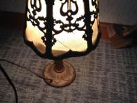 This antique lamp, made by the A.W. Reiser Co. Toledo,