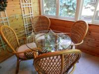 "Rattan: 4 chairs w/cushions. Table w/48"" glass"