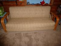 This beautiful Rattan Sleeper/Couch opens up into a