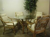 ? Beautiful rattan in a rich tan color. ? Four chairs