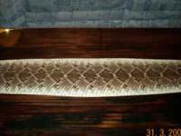 This top is 57 inch long 22 inch wide. The rattle snake