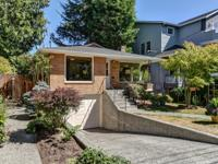 Sophisticated brick home centrally located next to