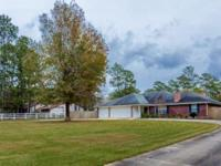 This beautifully maintained Rayburn Country home is