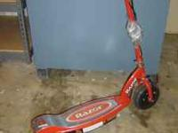 nice red razor scooter model e100 contact:heriberto or