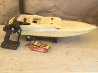 RC boat. Electric. Have no idea if it works. Maybe good