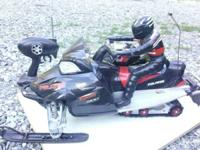 Electric r/c Polaris snowmobile. Picture describes it