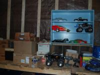 2 Complete RC Trucks with remotes and thousands of
