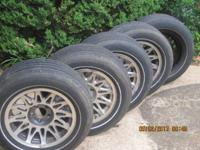 5 P225/60R16 97S Michelin Symmetry Tires mounted and