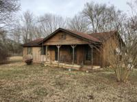 Great find on 16 acres with 3 horse barns. Home is in