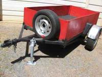 Real Nice 4 x 8 utility trailer; has 2 inch ball