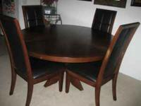 For sale is 1 round dining wood table and 4 leather