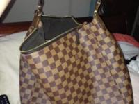 I am selling my Louis Vitton bag it's still in brand