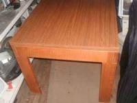 NIce heavy duty real wood table. formica top for