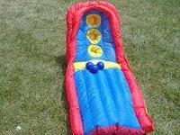 Inflatable skee ball game with 3 balls. Great for