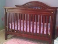 Very Pretty cherry wood convertable crib. Changes from