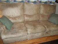 reclineing sofa and loveseat tan in color in very good