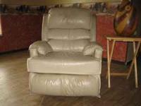 Nice leather or vinal beige recliner, rocker. Pretty