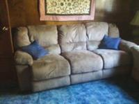 Couch $300.00 Both ends recline has a flip down table