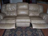 VERY NICE LEAHER SOFA WITH RECLINERS ON BOTH ENDS. TAN