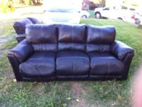 Dark brown faux leather reclining sofa. Both recliners