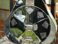 The Recording King Metal Body Mandolin is one of only