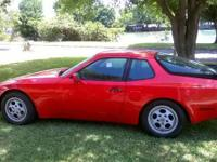 Turn heads with this sleek red classic 1987 Porsche