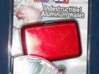 Brand new Red Aluma Wallet. Still in its original