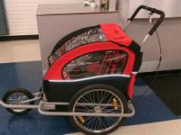 Red Bike Stroller. Tow behind your bike so your kids