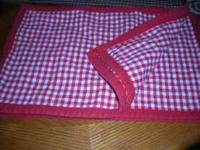 I have a set of four red checkered placemats for sale $