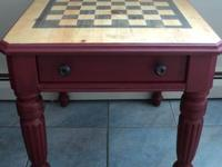 Stripped and hand finished solid wood table with