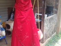 Size 12 red dress in exellent condition with no stains.