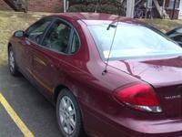 2006 red ford taurus,sedan, 3.0L, 176k miles, auto