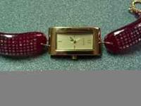 This is a hand made glass watch... It has gold on the