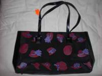 This tote bag is NEW. Black bag with design. Bag