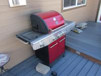 Red Kenmore propane grill