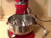 Red KitchenAid Professional 5 series stand mixer.