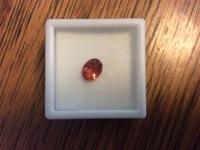 1..50 ct oval shaped red labradorite gemstone for sale.