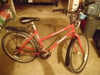 Used red lady's Trek 830 Mountain Bike.  Has some rust
