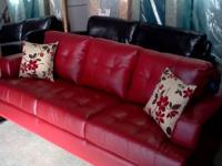 This contemporary red leather sofa/love seat group