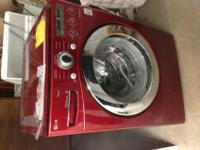 Red lg front load washer. Barely used,..still in