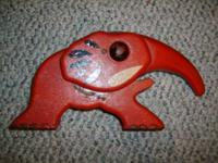 This is a Red Metal Elephant Iron Nut Cracker Made