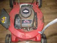 Red Mower Briggs and Stratton Motor $50.00 CALL TOMMY