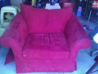 For sale is a red oversized chair that is in great